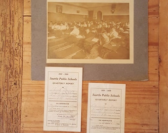 Antique photograph and two report cards from a 1915 Seattle schoolhouse
