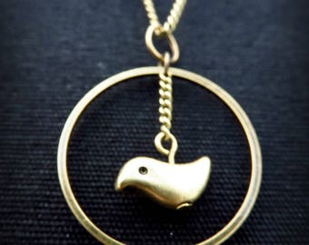 Long romantic bird in a brass circle