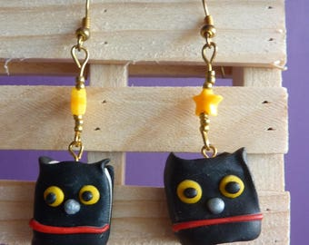 Golden metal earrings with a black book kawaii owl made with polymer clay and star bead