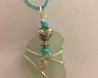 White sea glass necklace wrapped in silver wire with heart charm and turquoise color beads