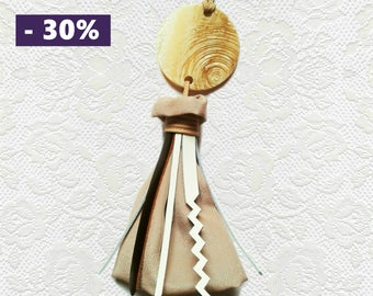Bag silk and leather tassel and mother of Pearl disc charm