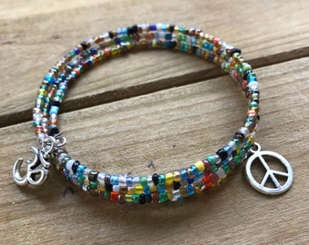 Beaded Bracelet with Om and Peace Sign Charms
