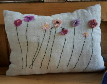 Hand-embroidered linen pillow with flowers