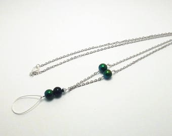 Silver necklace with green beads, black, a silver faceted Teardrop ring