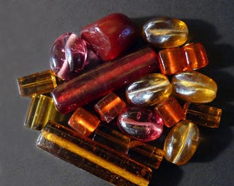19 Indian Red, amber of various shapes glass beads