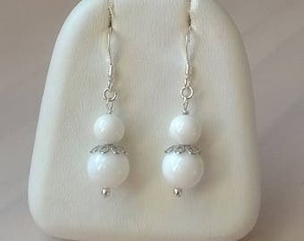 Earrings in 925 sterling silver clam beads