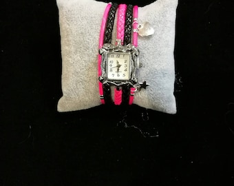 Hot pink and black multi strand wristwatch