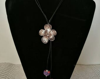 Long black leather, flower pendant necklace and purple European beads