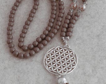 XL necklace made of acrylic beads and the flower of life with tassel