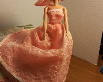 Handmade barbie clothes.  One of a kind handmade gown and handmade hat. Made to be pass down to the next generation.