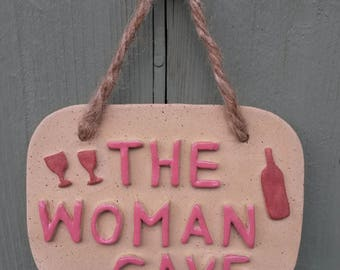The Woman Cave Sign