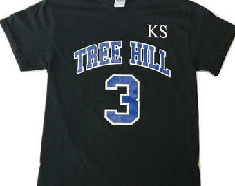 Men's or Womens TREE HILL RAVENS Keith Scott Memorial Tshirt worn by Lucas, Nathan and the guys during basketball games.