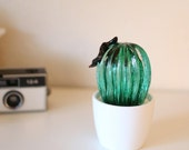 hand-blown green glass catcus with dark red flower