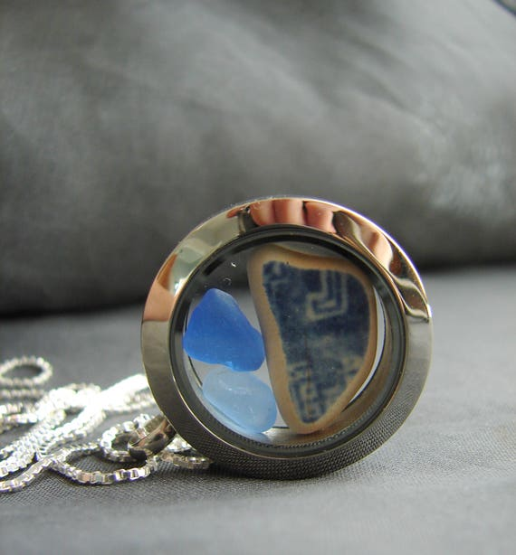 Porthole sea glass and sea pottery locket in blues