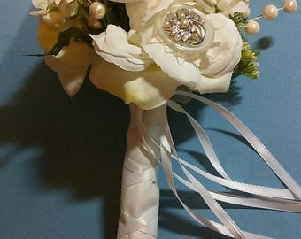 Custom designed button and broach bridal/ wedding bouquets, corsages, boutonnieres