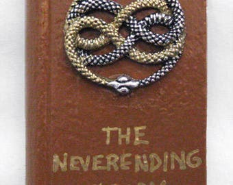 The Neverending Story book magnet, Auryn