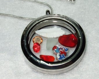 Is that an Otilith Memories of Newfoundland Locket Necklace with Sterling Silver Chain Made in Newfoundland Beach Glass Cods Ear Red Themed