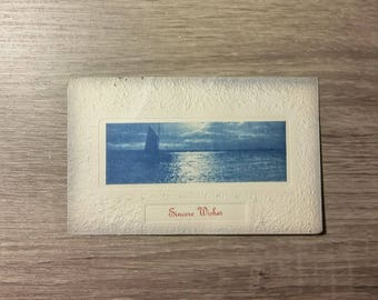 Antique embossed Sincere Wishes postcard featuring a boat on the water , 1914 Washington postmark and 1-cent Benjamin Franklin stamp