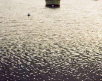 Fine art film portrait of fishing boats on Menemsha Harbor in Martha's Vineyard. Calm, serene, peaceful.