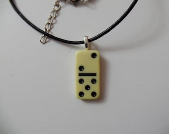 Domino Pendant 1-Inch Long x 1/2 Inch Wide, With An 18-Inch Leather Cord.