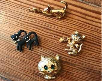 Assorted vintage gold tone kitty cat  pins,brooches
