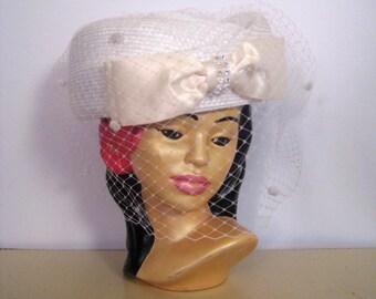 1950s 1960s white hat with cream satin rhinestone trimmed bow • mid-century straw hat with pom pom netting • vintage white wedding hat