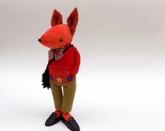 Velvet Fox  -  Handmade plush fox wearing felt pants, woolly pullover and plastic shoes.