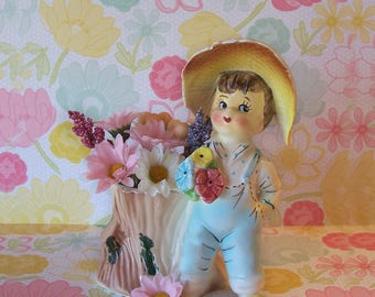 Vintage Country Girl in Bib Overalls standing by a Tree Stump Planter