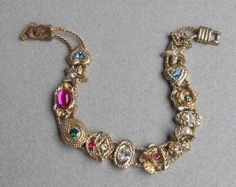 Unsigned Vintage GOLDETTE Slide 14 Charm Bracelet