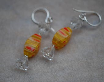 Ea-73 Ear Candy that looks like cellopane wrapped candy, but is Millefiore glass beads. Write for sterling silver screwbacks. Ear Candy.