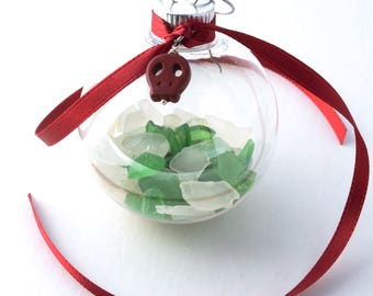 """Rhode Island White and Green Sea Glass in a 2"""" Plastic Ball Ornament with Red Ribbon with a Red Stone Sugar Skull"""