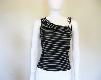 Asymmetrical black & white sleeveless top