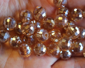30 beige or light orange depending on the light AB plated glass beads, round faceted, 10 mm, hole 1 mm