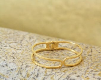 Bangle is 24 K Gold