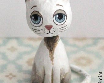 Mini cat sitting white and beige