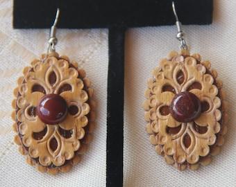 Birch bark earrings .