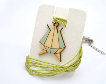 Laser cut wood pendants, engraved and hand-painted
