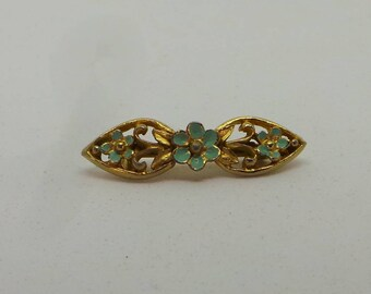 Vintage brooch . Gold and turquoise enameled floral brooch