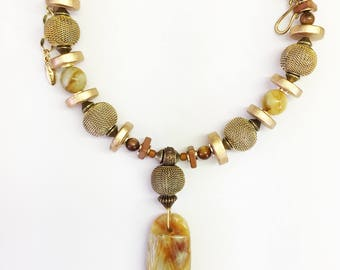Necklace One of a Kind Wire Wrapped Serpentine Pendant Metal Mesh Brown Mother of Pearl Beads Gold Tone Statement