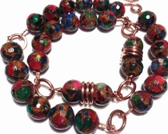 Necklace made of copper with pearls composed of fragments of roots of sapphire and Emerald Ruby