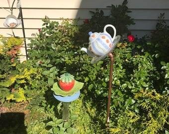 strawberries on blue teapot birdfeeder yard art