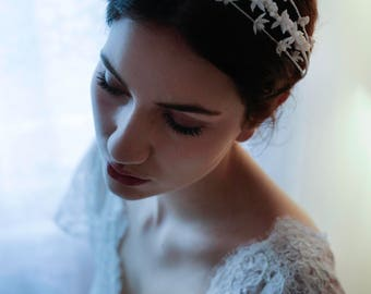 Three tiered handmade vintage inspired bridal headpieces decorated with wax flowers and flower buds