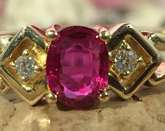 Natural oval ruby with two diamond accents 14k yellow gold