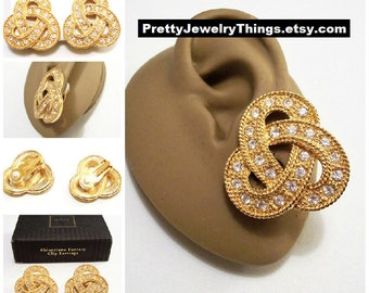 Avon Crystal Pretzel Clip On Earring Gold Tone Vintage 1995 Rhinestone Fantasy Wide Rope Edge Swirl Band Nail Head Accents Round Clear Stone