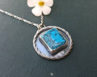 """Kingman Turquoise and Sterling Silver Necklace. Round Pendant with Square Kingman Stone & Twist Wire. On the Reverse 'be happy' on 18"""" chain"""