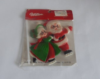 Wilton Santa Claus And Mrs. Claus Cake Topper
