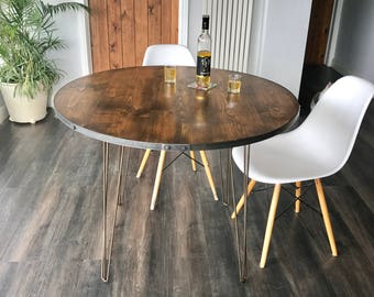 Reclaimed Industrial style dining table, distressed timber with steel band and blackened coach screw detailing, steel hairpin legs