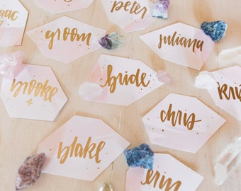 blush watercolor calligraphy place cards // handwritten gem shaped boho place cards in gold and silver pen // geode wedding stationery