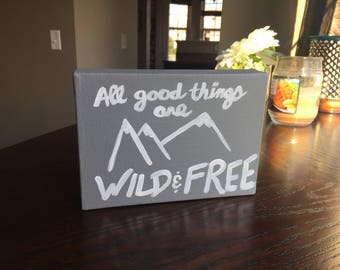 Table top all good things are wild and free sign