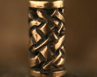 bronze openwork runestone bead